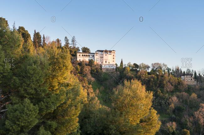 Spain, granada, albaicin, view to palacio del generalife, evening light