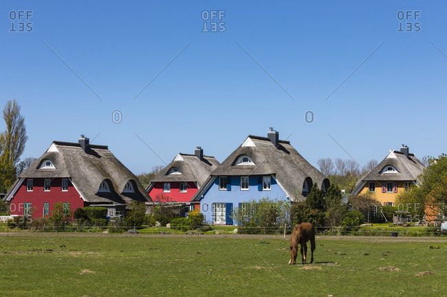 Colorful residential and holiday homes in ahrenshoop, fischland-zingst, mecklenburg-west pomerania, Germany