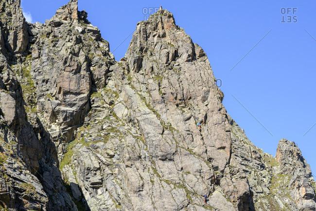 Austria, montafon, rock face with 2 climbers at the Saarbrucken hutte.