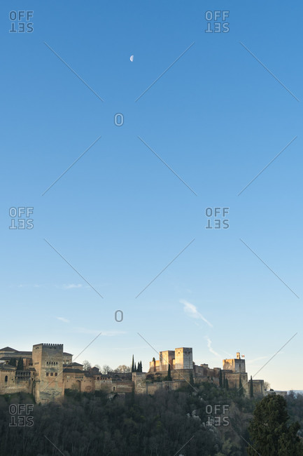 Granada (spain), view of the alhambra, morning sky with moon, copy space