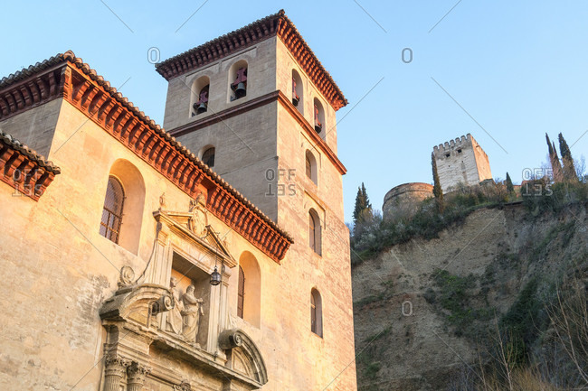 Spain, granada, albaicin, historic district, iglesia de san pedro and alhambra, evening light