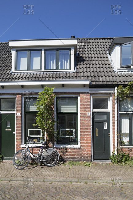 April 20, 2019: house in groningen with bike in front of it, netherlands
