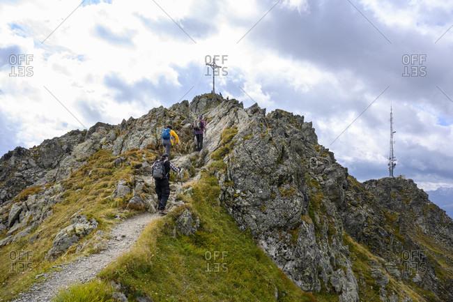 Austria, montafon, schruns, hikers on the way to the kreuzjoch summit (2398 m).