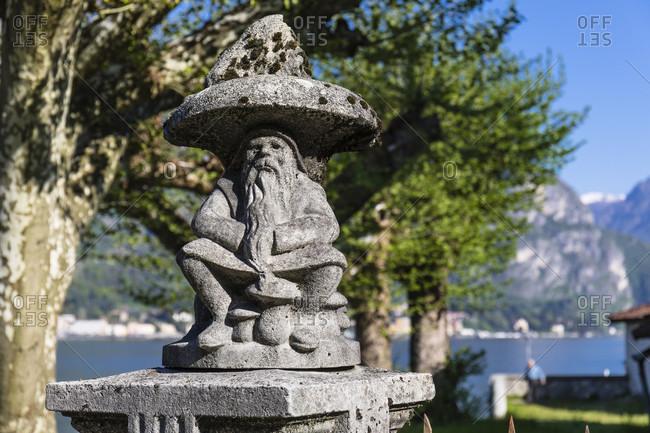 April 24, 2018: dwarf stone sculpture, bellagio, lake como, province of lecco, lombardy, italy