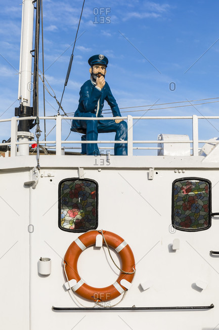 May 5, 2018: captain figure on a fish smokehouse boat, wismar, mecklenburg-west pomerania, Germany