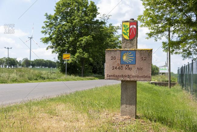 May 27, 2020: Germany, saxony-anhalt, rottmersleben, jakobsweg, 2440 km to santiago de compostela, signpost.