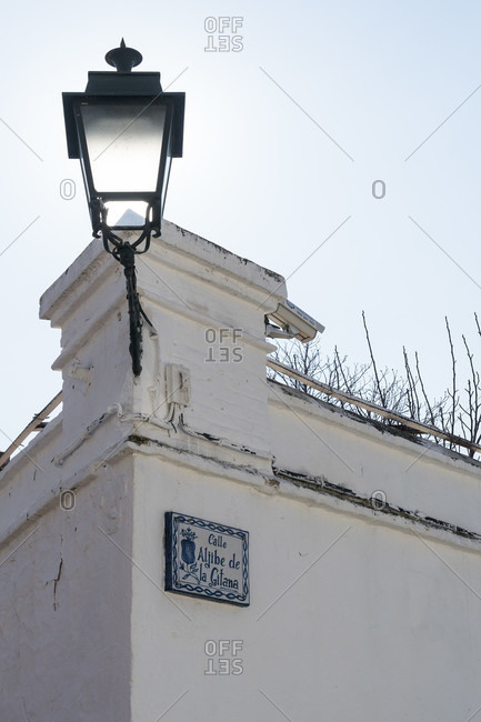 February 14, 2020: granada (spain), albaicin district, wall, lamp, calle aljibe de la gitana