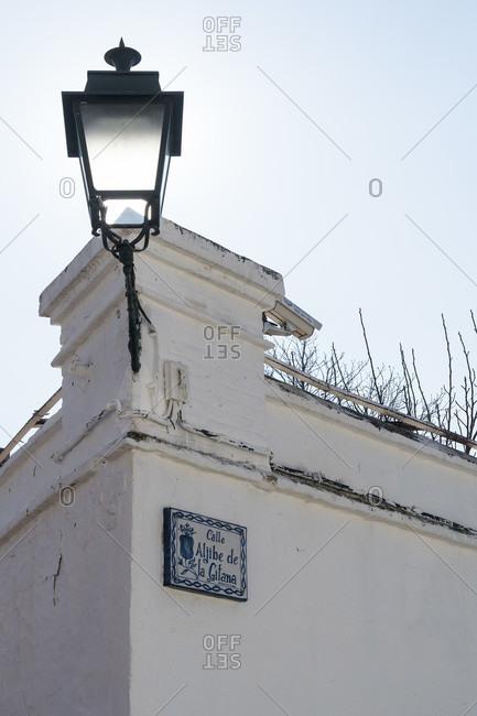 February 14, 2020: granada (spain), albaicin district, wall, lamp, calle aljibe de la gitana