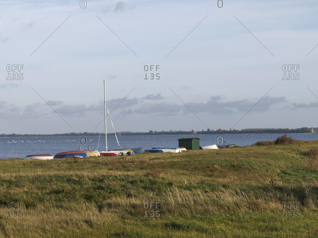 Boats on the east bank of hiddensee, in the background, ruegen, mecklenburg-west pomerania, Germany