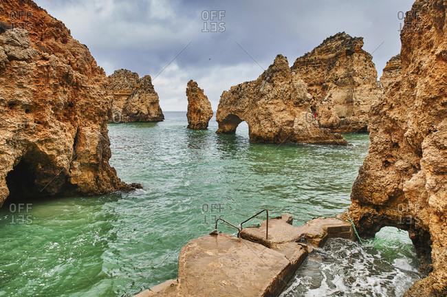 Europe, portugal, algarve, litoral, barlavento, felsalgarve, faro district, lagos, ponta da piedade, lagoon with jetty