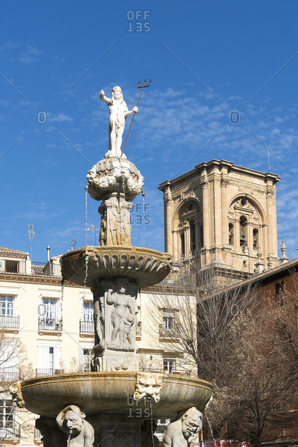 February 15, 2020: granada (spain), old town, plaza bib rambla, view to the cathedral, fountain