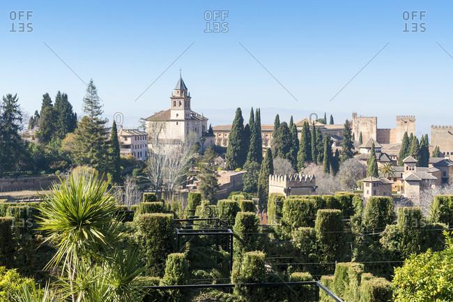 Spain, granada, generalife, jardines bajos, view of the alhambra, iglesia de santa maria de alhambra