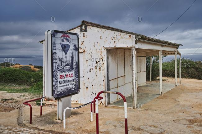 October 31, 2019: europe, portugal, algarve, litoral, barlavento, felsalgarve, district faro, lagos, old kiosk and billboard