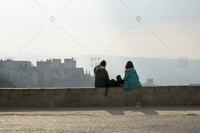 Spain, granada, sacromonte, historic district, abadia del sacromonte, monastery, viewpoint, alhambra view, two women from behind