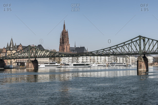 April 2, 2020: frankfurt am main, hesse, Germany. eiserner steg with the old town and frankfurt cathedral.