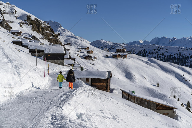 Europe, Switzerland, valais, belalp, mother and son on the winter hiking trail from belalp to the aletschbord