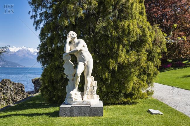 April 24, 2018: statue in the park of villa melzi, bellagio, lake como, province of lecco, lombardy, italy