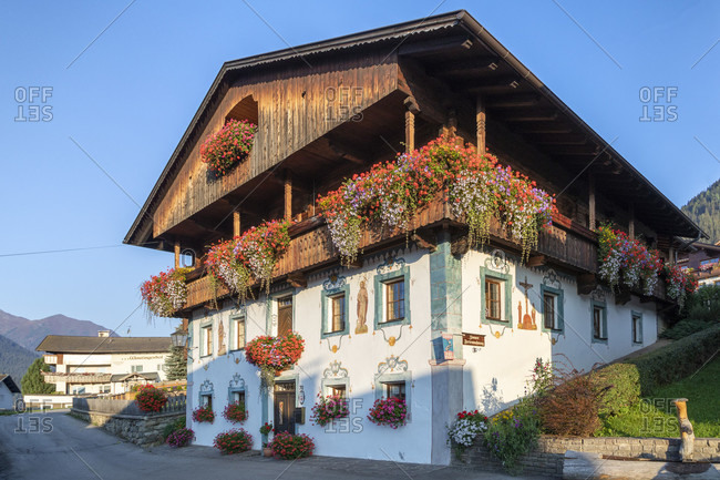September 18, 2018: obertilliach, typical facades of historic houses with decorations and blooms, district of lienz, east tyrol, Austria