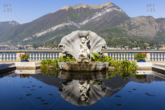 April 24, 2018: sculpture fountain in the park of villa melzi, bellagio, lake como, province of lecco, lombardy, italy