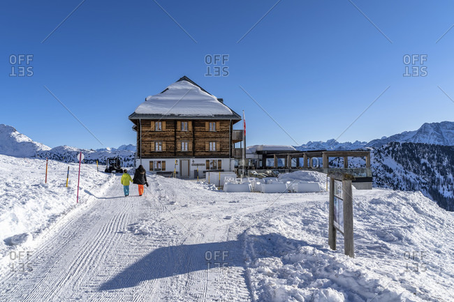 January 6, 2020: europe, Switzerland, valais, belalp, mother and son in front of the hotel belalp on the aletschbord