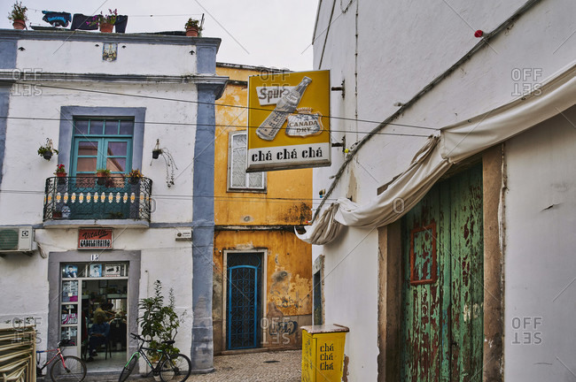 October 28, 2019: europe, portugal, algarve, litoral, sotavento, district faro, olhao, winding old town alley with bar and barber shop
