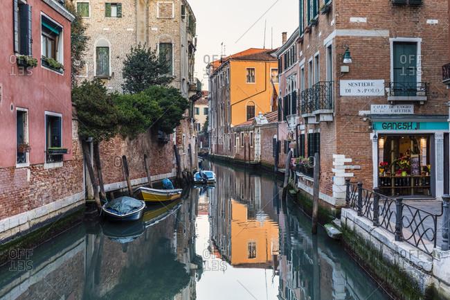 January 24, 2018: houses are reflected in the rio de san giacomo da l'orio in sestiere san polo, venice, veneto, italy