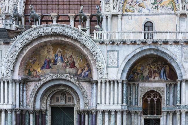 February 25, 2018: mosaic over the entrance portal of st. mark's basilica, st. mark's square, venice, venezia, venice province, veneto, italy