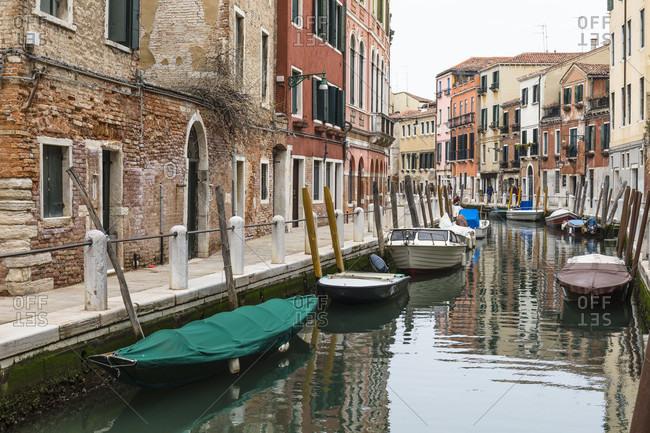 March 24, 2018: houses are reflected in the rio de la romite in the fondamente borgo, sestiere dorsoduro, venice, veneto, italy