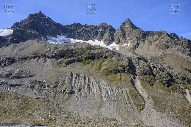 Austria, montafon, view from the wiesbadener hutte. soil erosion below the snow bell (3223 m) and the shade peak (3203 m).