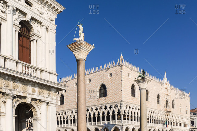 January 21, 2018: biblioteca nazionale marciana, columns of san marco and san todaro in front of the doge's palace, venice, veneto, italy