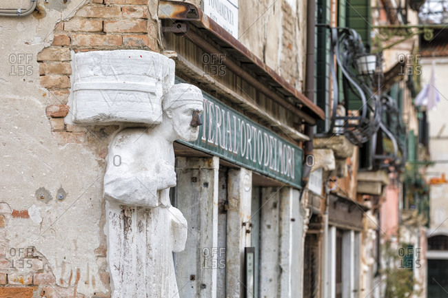 February 26, 2018: statue sior antonio rioba on the corner in campo dei mori, sestiere canaregio, venice, venezia, venice province, veneto, italy