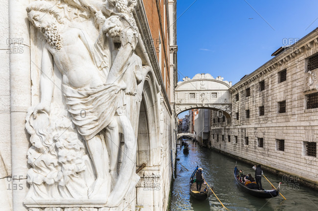 March 23, 2018: corner capital noah's drunkenness at the doge's palace with a view of the bridge of sighs, venice, veneto, italy