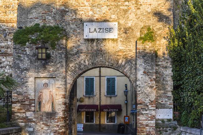 April 20, 2018: city gate porta del lion as access to the old town of lazise, lake garda, verona province, veneto, italy