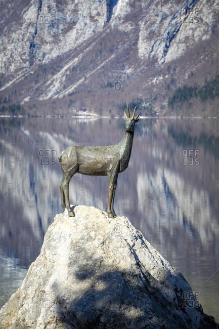 March 8, 2020: bohinj lake, the statue of zlatarog, the legendary chamois with golden horns, ribcev laz, upper carniola, triglav national park, slovenia