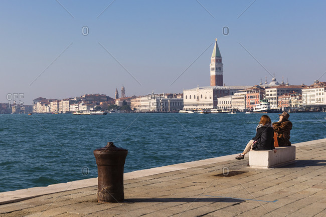 January 21, 2018: promenade on the lagoon with the town houses and the campanile in san marco in the background, venice, veneto, italy