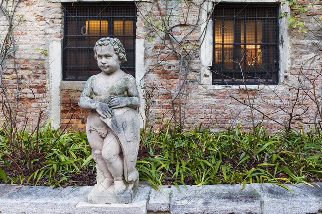 January 24, 2018: statue in the garden of the palazzetto bru zane, center de musique romantique française, sestiere san polo, venice, veneto, italy