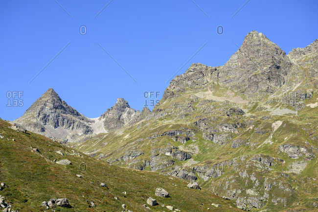 Austria, montafon, view from the southern end of lake silvretta to the lobspitze, the lobturm and the far right to the middle lobspitze.