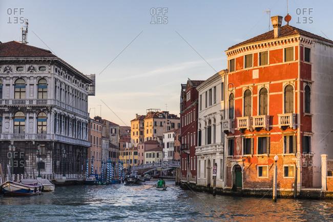 January 24, 2018: boats at the ponte delle guglie, also ponte di cannaregio, it spans the canale di cannaregio, sestiere cannaregio, venice, veneto, italy