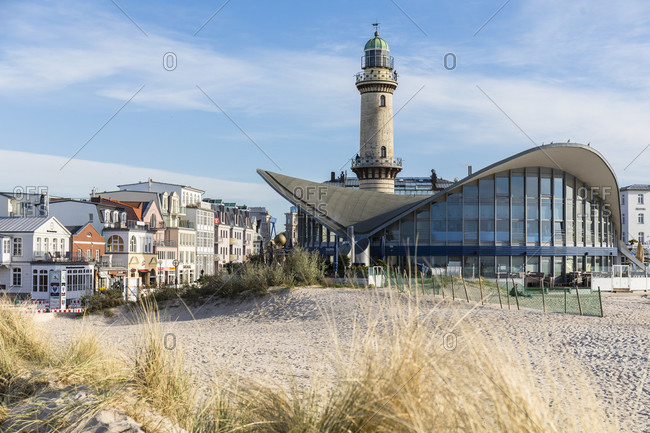 May 4, 2018: view from the beach over dune grass to the tea pot and lighthouse in the evening, anemone, rostock, mecklenburg-west pomerania, Germany