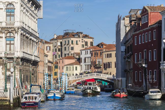 January 24, 2018: boat traffic on the ponte delle guglie, also ponte di cannaregio, it spans the canale di cannaregio, sestiere cannaregio, venice, veneto, italy