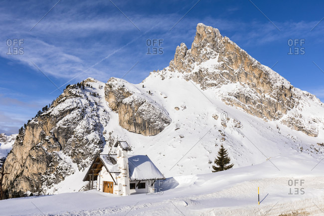 February 24, 2018: chapel in front of the hexenstein or sas de stria (2477m) on the falzaregopass, winter, cortina d'ampezzo, dolomites, province of belluno, veneto, italy