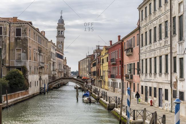 February 25, 2018: rio della pietà in the castello district with bell tower of the chiesa san giorgio dei greci, venice, venezia, venice province, veneto, italy