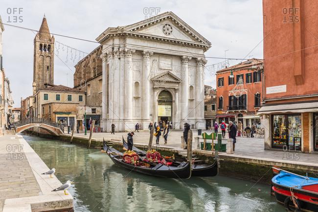 February 26, 2018: gondola on the rio san barnaba in front of the san barnaba church at campo san barnaba, venice, venezia, venice province, veneto, italy