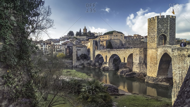 Pont vell over the fluvial river in basal. the place has been recognized as a cultural asset (bien de inters cultural) in the conjunto historico-artistico category since 1966. the bridge was built around 1315.