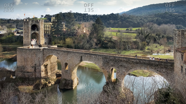 February 18, 2017: punt vell over the fluvial river in basal. the place has been recognized as a cultural asset (bien de inters cultural) in the conjunto historico-artistico category since 1966. the bridge was built around 1315.