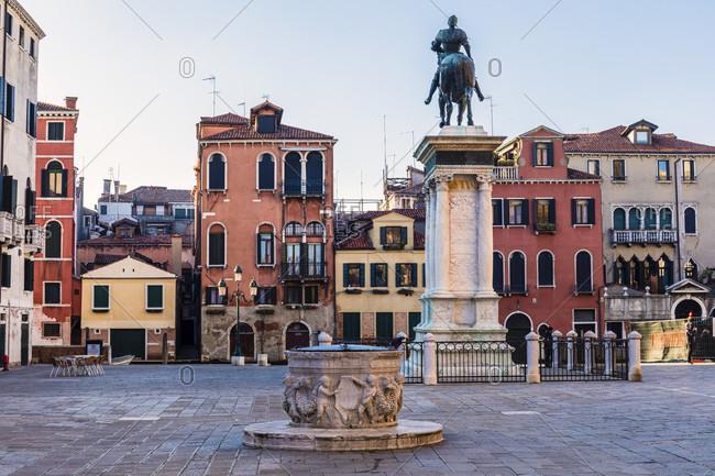 January 21, 2018: equestrian monument of the condottiere Bartolomeo Colleoni in front of the scuola grande di san marco, now a hospital and the basilica santi giovanni e paolo, campo di s. giovanni e paolo, venice, veneto, italy