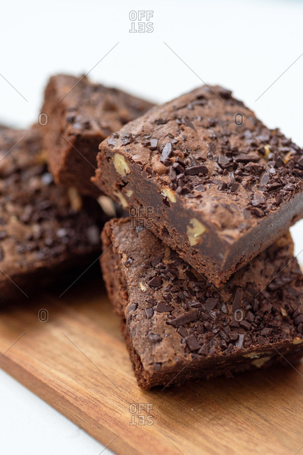 Top view of stacked brownies on white background