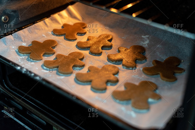 Close up of Gingerbread Men on a baking tray at the oven