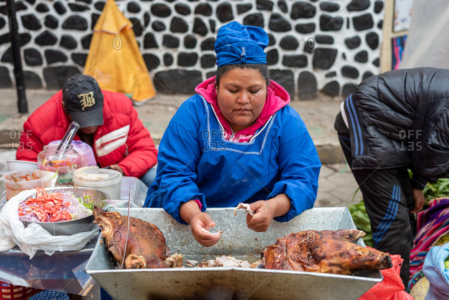 February 24, 2020: Woman selling street food in the street. Potosi, Bolivia