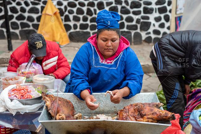 February 24, 2020: Woman selling street food in the street. Potosi, Bolivia